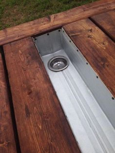 This is a sturdy picnic table with built-in trough for ice, condiments, or drinks. The trough feature has become a requested item on our picnic tables. The strainer /drainer comes in handy for special Outdoor Picnic Tables, Patio Table, Backyard Patio, Backyard Landscaping, Diy Picnic Table, Picnic Table Cooler, Patio Bar, Wood Table, Diy Outdoor Furniture