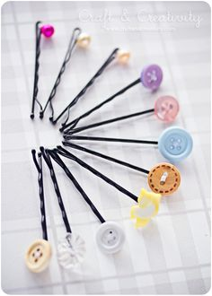 Sew the button on to the bobby pin, add some super glue to provide extra stability and voilá – new, pretty hair pins!