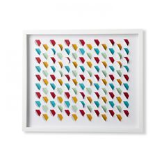 A touch of texture takes this framed wall art from cool to extraordinary. Die-cut honeycomb shapes give it a real pop that continues the charm of the bright colors peeking through.