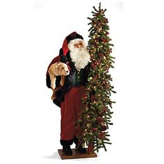 The sight of Santa with a Puppy, holding a tiny golden Labrador retriever in one hand and a 6 ft. tree in the other, is a warm and wonderful greeting. Handcrafted in Ohio, Santa has kindly bespectacled eyes and wears a classic red suit trimmed with faux ermine. The lighted holiday tree is richly decorated with glittering red berries, leaves, and pinecones.