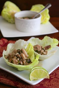 Thai Basil Chicken Wraps - Serve spicy Thai Basil Chicken in crisp iceberg lettuce cups for a delicious low carb appetizer or main dish. It's easy to make and paleo-friendly.