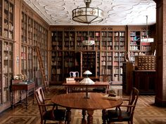 """""""Medical Manuscripts & More"""" -- Click through for a nice post about the New York Academy of Medicine's library. Loving the ceiling and floor, the lights and lamps, the carved wood, the card catalog, and the skulls pictured here... Could I move in, please?"""