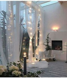 Sheer draping as and lights. Could I do this around back porch?