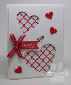 """Outside of """"I love you"""" card with cutout hearts on doublesided paper. Have to be facing down on short side of card."""