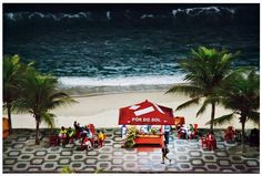 Ipanema Beach; the promenade pattern is by renowned Sao Paulo-born landscape architect Roberto Burle Marx; and the stand sells cachaya, coconuts, and cerveja and I WANT TO GO THERE.