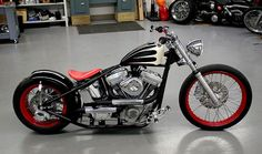 Black and white 66 Bobber with 21in front tire by SuckerPunch Sallys, via Flickr