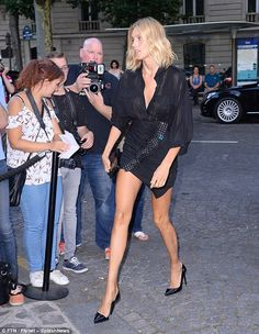 Here she comes:The Polish model, 34, looked typically stunning in a sheer black blouse an...