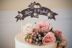 love this cake topper banner with flowers