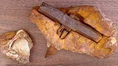 This iron and wooden hammer, also known as the London Artifact was found by local hikers in a creek bed near London, Texas. The hammer, which was partially embedded in a small limy, rock concretion, originated in a Cretaceous rock formation (100 million-years-old), thus contradicting the conventional geological timetable.