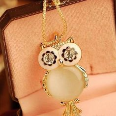 Experience the feeling of being in direct contact with art wearing this owl shaped pendant alloy rhinestone necklace. Made of alloy and rhinestone that makes it more attractive and classy. Suits to an