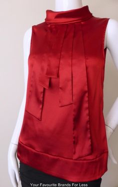 CUE TOP Size 8 US 4 Dark RED Satin Made IN Australia Fabric From Germany | eBay An elegant dark red satin top from Cue. It is sleeveless and has a turtle-neck with 4 self styled buttons.  The front features five wide satin strips extending from the middle of the neck-line. It has a hidden side zip and is unlined. The material has stretch.