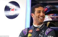 Australian Daniel Ricciardo is in good spirits as he looks on in the Red Bull Racing team garage
