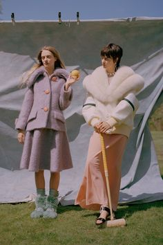 The Moncreiff Sisters - Idina wears felt boucle jacket felt boucle & crystal skirt, boots all by Miu Miu. Alexandra wears coat, crepe-de-chine dress, satin, crystal & metal shoes, crystal earrings, crystal necklace all by Miu Miu.