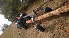 This is a picture of the log arch I built for $800. You can easily pull very heavy logs behind the tractor, or even my ATV with ease. I moved 13 large logs all by myself this day. WoodMizer LT15