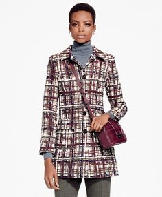 "Made of stretch jacquard cotton from Italy, this single-breasted coat features a custom plaid pattern that beautifully complements its classic car coat design. To complete the look, this vintage-inspired coat is fully lined with a contrast interior grosgrain.<br><br>31 ½""; dry-clean only; woven and made in Italy."