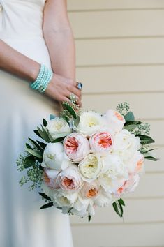 light pink garden rose bouquet, photo by John Newsome http://ruffledblog.com/romantic-la-jolla-beach-wedding #flowers #bouquet #gardenrose