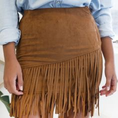 FRINGE SKIRT  $10.00  Wouldn't you agree that fringe is an eye-catcher? Specially if it is subtly accenting the hem of a skirt, the strands dances with every gentle breeze.  Enjoy the fun detailing in this Sexy Faux Leather above the knee Fringe Skirt.There are plenty of ways to make this flexible trend work for your fashion persona!