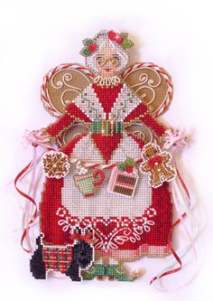 New cross stitch from Brooke Nolan, Spirit of Mrs. Claus, uses Kreinik metallics.