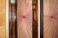 Ultimate luxury dressing room with marquetry, leather floor and patinated bronze. Starburst doors.
