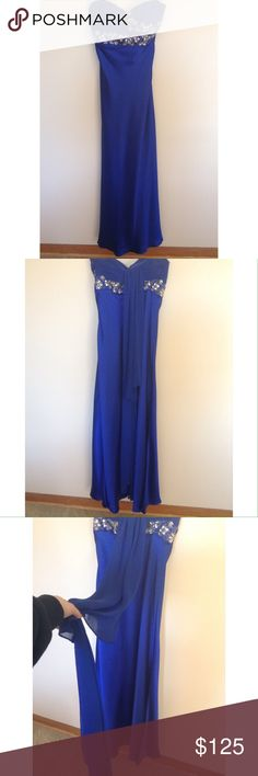 STUNNING 'vintage' royal blue prom dress Strapless prom dress. Beautiful royal blue color with beading and a train going down the back. I don't know the designer, how 'vintage' it is or the exact size as the tag was already removed when I bought it. For reference, I am 5'4 size two and did not need it altered. Dresses Prom