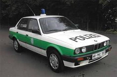 ✿1989 BMW 318 Police Car✿ Bmw 318i, Bmw E30, Bmw Cars, Cartoon Network Adventure Time, Police Cars, Police Vehicles, German Police, Car Badges, Police Uniforms