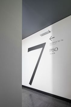 P-07 Atelier | Lisbon \ Portugal. #signage #design #sign #arrow #direction #black #floor #level #wayfinding #wall #white #seven