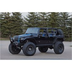 Black and blue [racing stripe] Jeep Wrangler Unlimited w/ big black off road wheels and lift.