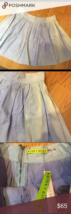 "NWT ALICE + OLIVIA PLEATED LAMBSKIN SKIRT Please read! This skirt has damage due to the sun. It can be worn with an ""acid wash"" look, or can be re-dyed. 100% super soft lambskin. Pleated style with back zip. Brand new with original tags still attached. Alice + Olivia Skirts Circle & Skater"
