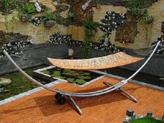 It's patio furniture time again, and this year hammocks are more stylish than ever. The Arc Wood Hammock Stand shown here with the El Natural hammock bed looks Hammock Swing, Outdoor Settings, Outdoor Furniture, Outdoor Decor, Furniture Making, Curb Appeal, Sun Lounger, Relax, Steel