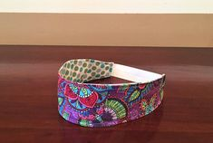 Reversible Headband Teen Headband Multicolor Headband Polka  Cute reversible headband made from 100% cotton. Purple, blue, green, orange, yellow and red floral print on one side. White with blue and green polka dots on the other side. The Headband is wider at the top and tapers towards the ear with white fold over elastic at the base of the neck for a good fit. #colorful #headbband #hairaccessores #giftsforher #etsy #etsyshop #handmade