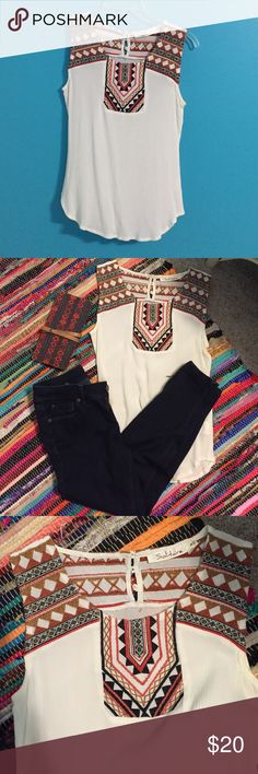 | Solitaire | Aztec print sleeveless shirt Lightly worn, form fitting, and off white. Features three button closure in back as well as brown and orange Aztec details. Very chic and figure appealing shirt. Size: small.                  Bundles on 2+ items reasonable offers are welcome Solitaire Tops Blouses