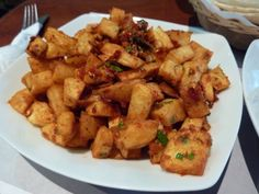 Spicy potatoes are a popular street snack in Cairo, but they make a great side dish anywhere