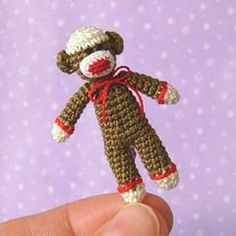 Found at Amigurumipatterns.net. This will make the next one I make easier - I winged the pattern before.  I put a red pom pom on his hat also.