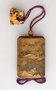 Kajikawa School (Japan, died N/A)   Inro, Ojime, Netsuke, 19th century  Costume/clothing accessory/waistwear, Four-case inro with gold takamakie with design of flowering plum tree, house, and ducks on black lacquer; gold lacquer bead ojime; ivory pair of Chinese lions netsuke