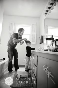 One of the best pictures ever!! Gotta love daddies doing little girls' hair.