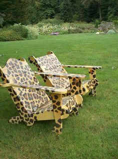 A pair of animal print chairs on the lawn. Chanticleer Gardens, Wayne, Pennsylvania.