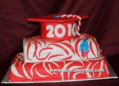 Inspired by our Book Smart graduation cake, this graduate wanted a more stylish representation of her personality. Zebra print in red and white fondant cover the bottom two tiers while the top tier grad cap is solid red. Fun turquoise accents were added to the red and white tassel.    Order this Item
