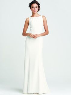 A chic floor-length gown with a clean, minimal silhouette. An elegant back cutout makes a stylish statement. Delicate shirring at the bateau neckline adds a flatte