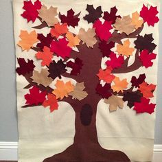 A felt tree for fall! With this tree you can do all the seasons and then change out your Christmas felt tree for that time of year. really love having the large felt piece behind and hanging it in command hooks instead of taping to your wall...