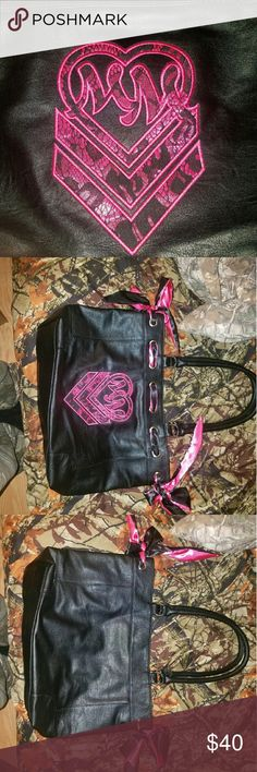 Metal Mulisha Purse NWOT ????BUNDLE TO SAVE  ????ALL purchases and bundles come with a FREE gift   BRAND NEW metal mulisha purse never has been used.  I absolutely love this bag but I have way too many purses and I need to downsize . Metal Mulisha  Bags