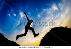 Jumping boy during sunset in Silhouette by manzrussali, via Shutterstock