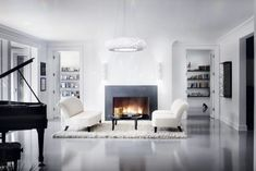 19 Aug 2010 --- Modern family room with glowing fireplace and grand piano in this Chicago IL residence. --- Image by © Michael Robinson/Corbis Room Rugs, Rugs In Living Room, Dining Rooms, Kitchen Wall Cabinets, Driven By Decor, Colored Ceiling, Simple Living Room, Crystal Decor, Crystal Chandeliers