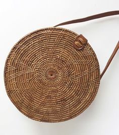 A beautiful round woven bag, a perfect accessory for any outfit. Free delivery on orders of or more. Custom Purses, Key Bag, Jute Bags, Woven Bags, Basket Bag, Summer Bags, Prada Handbags, Womens Purses, Ethical Fashion
