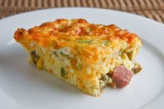 Ham and Cheese Egg Casserole    10 eggs  1 cup cottage cheese  1 cup ham (diced)  1 cup cheddar cheese (grated)  1/4 cup jalapeno peppers (sliced)  2 green onions (chopped)  salt and pepper to taste    1. Mix everything in a bowl.  2. Pour into an 8 inch square baking pan.  3. Bake in a preheated 375F oven until the eggs are firmly set and golden brown on top, about 25-35 minutes.