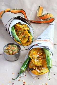 Awesome presentation of this crispy potato bhajia! Newspaper cones with a ribbon and whole chili's sticking out, plus a chutney on the side. Check out the awesome recipe - both the bhajia and the cucumber chutney are simple and robust!