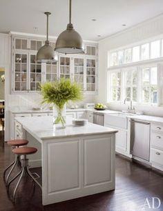 white cabinets + grey island.