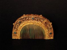 An Important Gold and Ivory Comb, Probably Tang Dynasty (618-907)  48,800.00$. 9cm wide. Decorated with fine filigree work on the both sides, inset with well polished malachite, the spine with small coral beads. Source: http://mossgreen.com.au/