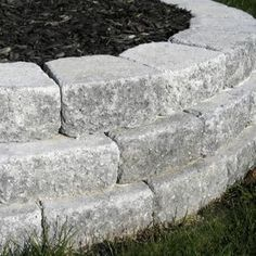 Staggered rows of pavers adds strength to raised bed walls.