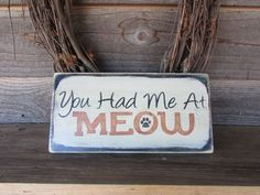 "funny cat sign, funny pet sign, made of wood and hand painted and distressed to give the look of an aged sign. it measures 7 "" X 12"", and comes ready to hang with hanger on the back."