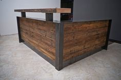 This is an ADA (Americans with Disabilities) reception desk. It is made of reclaimed and recycled materials. The length of the front wall and